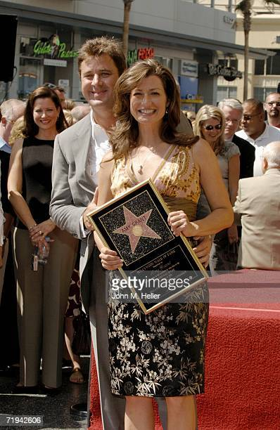 Vince Gill and Amy Grant attend the unveiling of her star on The Hollywood Walk of Fame September 19 2006 in Hollywood California