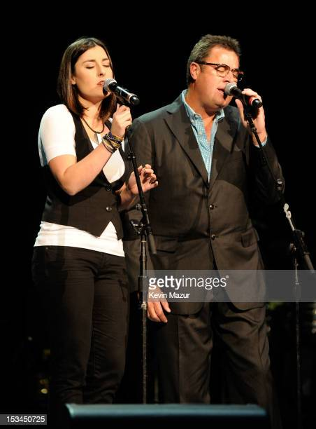 Vince Gill and his daughter perform on stage at the Children's Health Fund 25th Anniversary Concert at Radio City Music Hall on October 4 2012 in New...