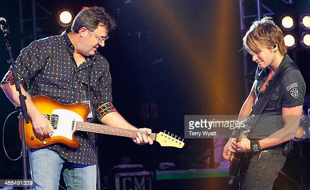 Vince Gill and Keith Urban perform on stage during Keith Urban's Fifth Annual We're All 4 The Hall Benefit Concert at the Bridgestone Arena on May 6...