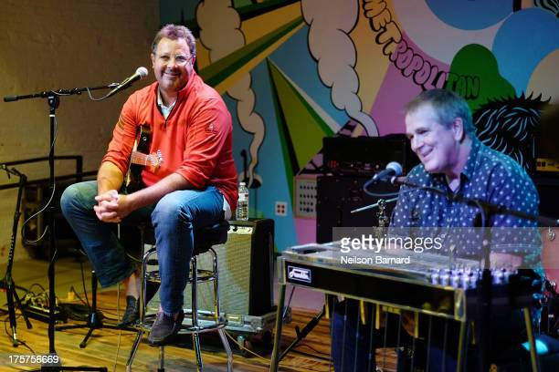 Vince Gill and Paul Franklin speak to camp students during the CBS/Vince Gill Day at GRAMMY Camp at Converse Rubber Tracks Studio on August 7 2013 in...