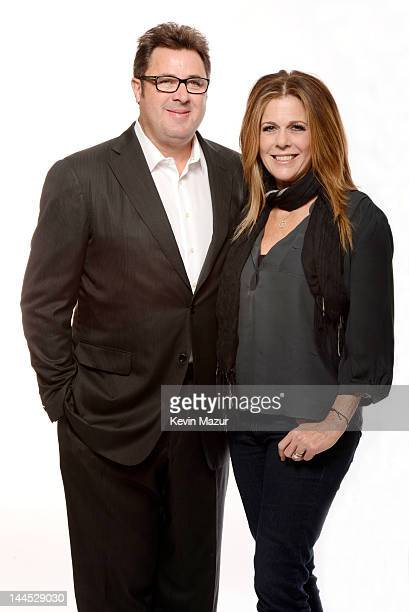 Vince Gill and Rita Wilson pose for a portrait during the Revlon concert for the Rainforest Fund at Carnegie Hall on April 3 2012 in New York City