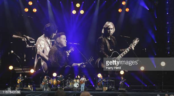 Vince Gill and Timothy B Schmit and Don Henley and Deacon Frey and Joe Walsh and Steuart Smith of the Eagles perform at Wembley Stadium on June 23...
