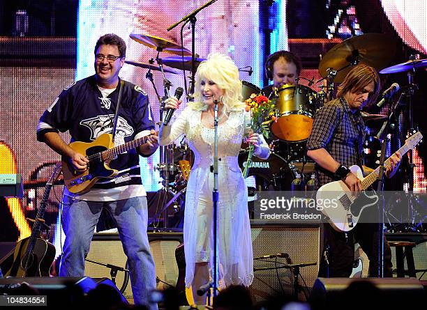 Vince Gill Dolly Parton and Keith Urban perform onstage at the 2010 We're All For The Hall benefit concert at the Bridgestone Arena on October 5 2010...