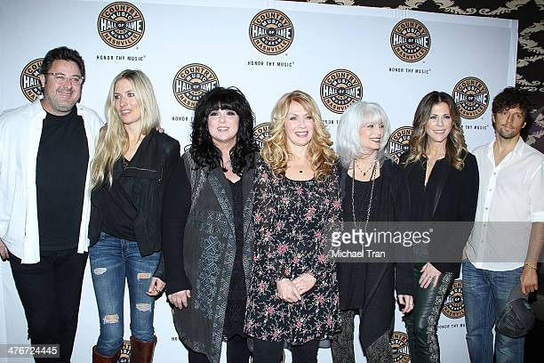 Vince Gill Holly Williams Ann Wilson Nancy Wilson Emmylou Harris actress Rita Wilson and musician Jason Mraz arrive at the Country Music Hall of Fame...
