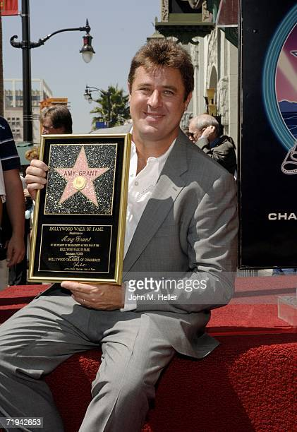 Vince Gill poses at the unveiling of Amy Grant's star on The Hollywood Walk of Fame September 19 2006 in Hollywood California