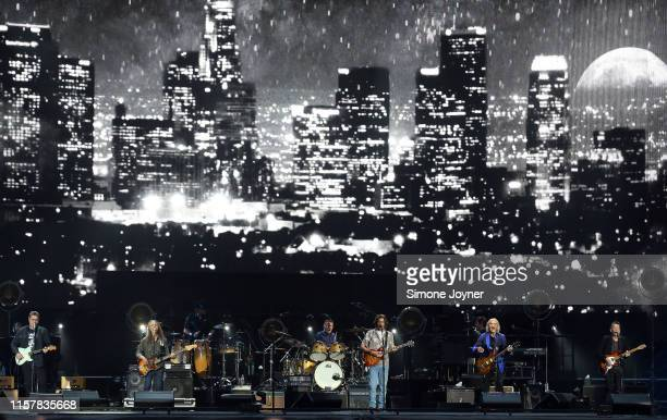 Vince Gill, Timothy B. Schmit, Don Henley, Deacon Frey, Joe Walsh and Steuart Smith of The Eagles perform live on stage at Wembley Stadium on June...