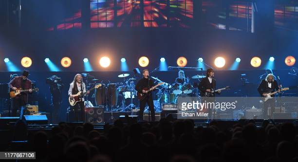 Vince Gill Timothy B Schmit Don Henley Scott F Crago Deacon Frey and Joe Walsh of the Eagles perform at MGM Grand Garden Arena on September 27 2019...