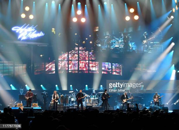 Vince Gill, Timothy B. Schmit, Don Henley, Scott F. Crago, Deacon Frey, Joe Walsh and Steuart Smith of the Eagles perform at MGM Grand Garden Arena...