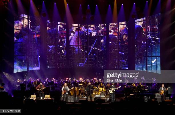 Vince Gill, Timothy B. Schmit, Don Henley, Scott F. Crago, Deacon Frey, Joe Walsh and Steuart Smith of the Eagles perform with an orchestra at MGM...