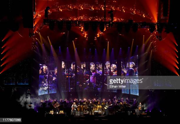 Vince Gill Timothy B Schmit Don Henley Scott F Crago Deacon Frey Joe Walsh and Steuart Smith of the Eagles perform with an orchestra at MGM Grand...