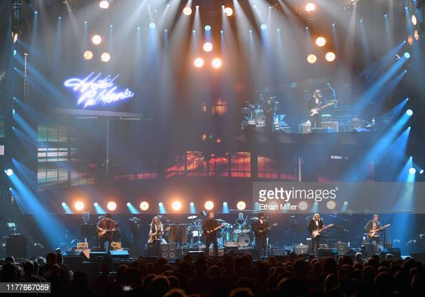 Vince Gill Timothy B Schmit Don Henley Scott F Crago Deacon Frey Joe Walsh and Steuart Smith of the Eagles perform at MGM Grand Garden Arena on...