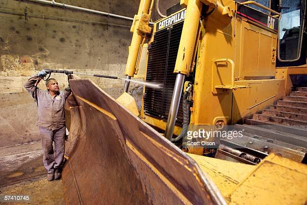 Vince Gonzalez washes earth moving equipment made by Caterpillar at Patten Industries on April 2006 in Elmhurst Illinois Heavy equipment maker...