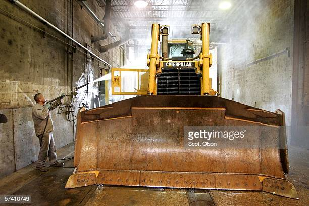 Vince Gonzalez washes earth moving equipment made by Caterpillar at Patten Industries on April 24 2006 in Elmhurst Illinois Heavy equipment maker...