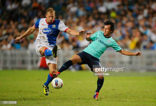 Vince Grella of Blackburn Rovers and Lo Kwan Yee of Kitchee compete for the ball during the Asia Trophy preseason friendly match at the Hong Kong...