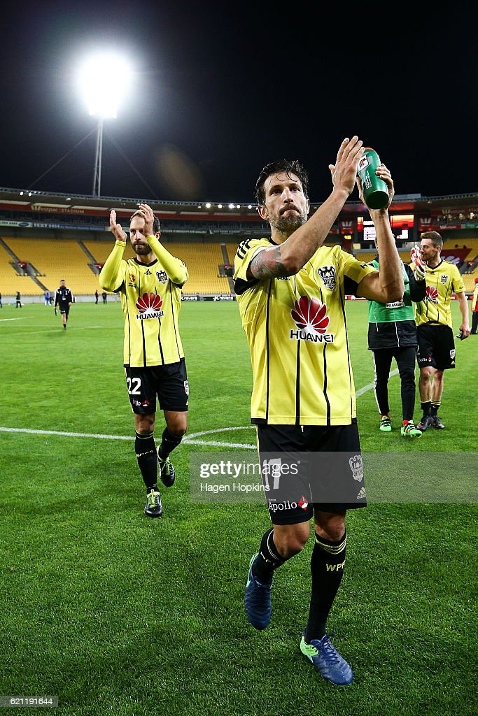 Vince Lia and Andrew Durante of the Phoenix leave the field after playing their 200th and 250th A-League game respectively during the round five A-League match between the Wellington Phoenix and the Newcastle Jets at Westpac Stadium on November 5, 2016 in Wellington, New Zealand.