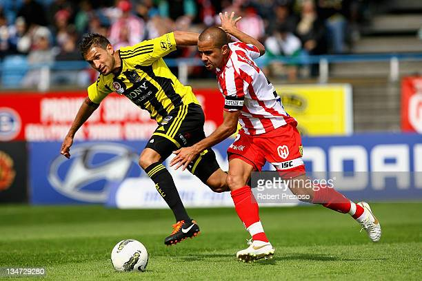 Vince Lia of the Phoenix and Fred of the Heart contest the ball during the round nine A-League match between the Melbourne Heart and the Wellington...