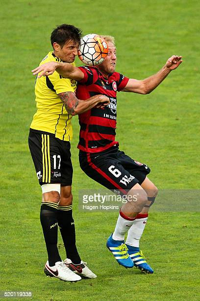Vince Lia of the Phoenix and Mitch Nichols of the Wanderers compete for a header during the round 27 ALeague match between the Wellington Phoenix and...