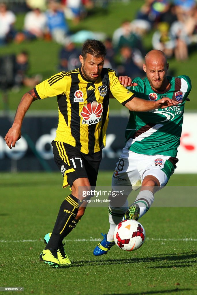 Vince Lia of the Phoenix holds off the challenge of Ruben Zadkovich of the Jets during the round three A-League match between Wellington Phoenix and the Newcastle Jets at McLean Park on October 27, 2013 in Napier, New Zealand.