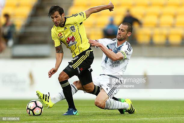 Vince Lia of the Phoenix is tackled by Carl Valeri of Melbourne Victory during the round seven ALeague match between the Wellington Phoenix and the...
