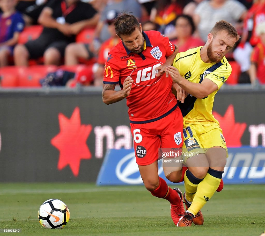 Vince Lia of United and Connor Pain of the Mariners compete for the ball during the round 12 A-League match between Adelaide United and the Central Coast Mariners at Coopers Stadium on December 26, 2017 in Adelaide, Australia.