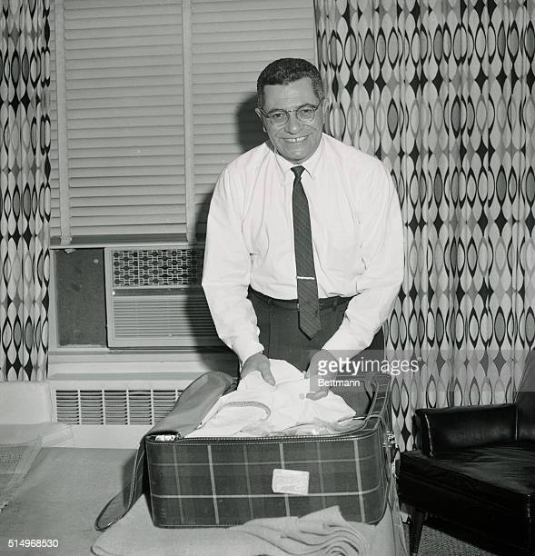 Vince Lombardi backfield coach of the new York Giants packs his bag at the Manhattan Hotel here January 28th after he was named General manager and...