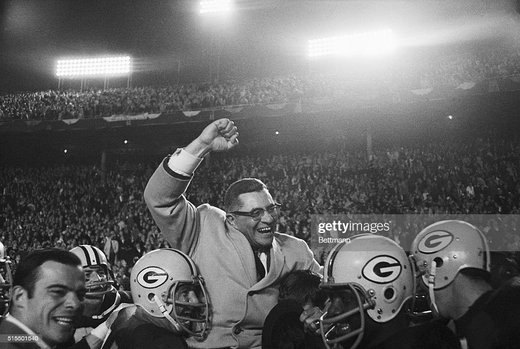Vince Lombardi Being Carried by Football Players : News Photo