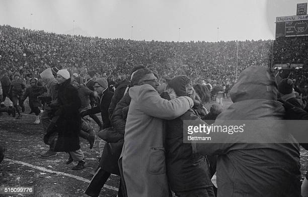 Vince Lombardi coach of the Green Bay Packers struggles with youthful fan who stole his hat after NFL championship game here December 31 Packers won...