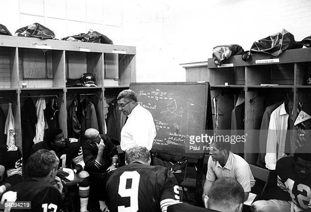 Vince Lombardi Hall of Fame head coach and general manager of the Washington Redskins talks to his team in the locker room before the Redskins 2723...