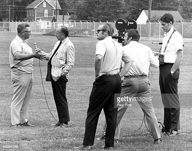 Vince Lombardi the new head coach and general manager of the Washington Redskins conducts an interview at his first training camp at Dickinson...