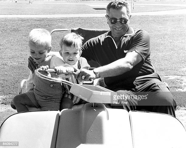Vince Lombardi the new head coach and general manager of the Washington Redskins shares a light moment with his grandchildren at his first training...