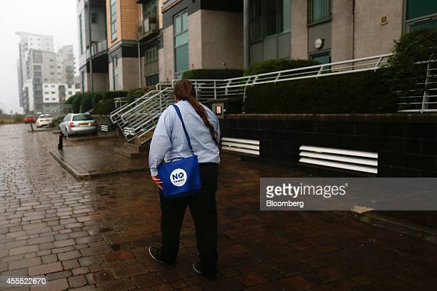 Vince Maple leader of the Labour Medway Group and antiindependence Better Together campaigner carries a 'no' branded bag as he looks for prospective...