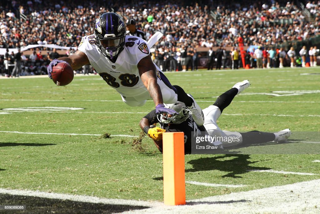 Vince Mayle #88 of the Baltimore Ravens dives for a touchdown against the Oakland Raiders during their NFL game at Oakland-Alameda County Coliseum on October 8, 2017 in Oakland, California.