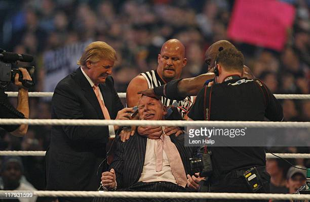 Vince McMahon gets his head shaved by Stone Cold Steve Austin after as Donald Trump looks on at WrestleMania 23 at Detroit's Ford Field, Detroit...