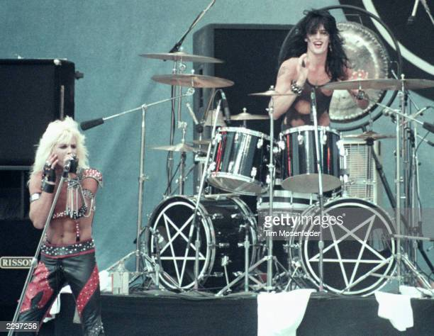 Vince Neil and Tommy Lee of Motley Crue performing at the US Festival in San Bernadino Calif 1983 Image By Tim Mosenfelder/ImageDirect