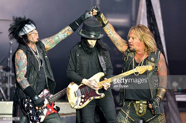 Vince Neil Mick Mars and Nikki Sixx of Motley Crue perform live on stage on Day 3 of the Download Festival at Donington Park on June 14 2015 in...