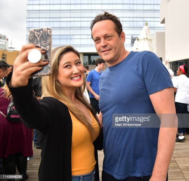 Vince Vaughn takes a photograph with a fan at the Netflix Adult Animation QA and Reception on April 20 2019 in Hollywood California