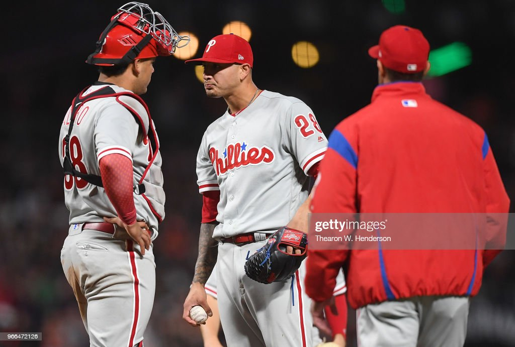 Vince Velasquez #28 and Jorge Alfaro #38 of the Philadelphia Phillies stand on the mound waiting on manager Gabe Kapler #22 to come take Velasquez out of the game against the San Francisco Giants in the bottom of the seventh inning at AT&T Park on June 2, 2018 in San Francisco, California.