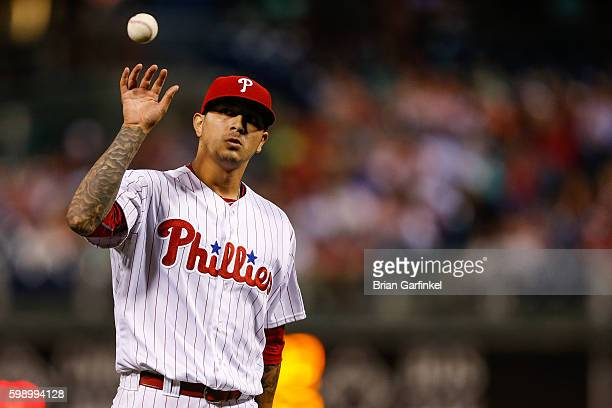 Vince Velasquez of the Philadelphia Phillies catches the ball after giving up a second home run to Adonis Garcia of the Atlanta Braves in the sixth...
