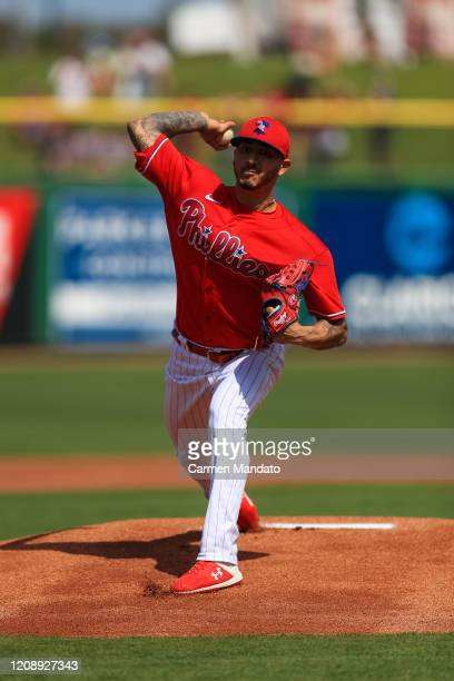 Vince Velasquez of the Philadelphia Phillies delivers during a spring training game against the Baltimore Orioles at Spectrum Field on February 24,...