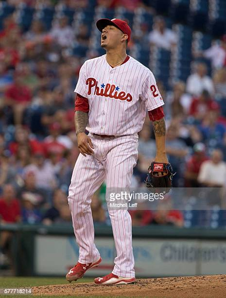 Vince Velasquez of the Philadelphia Phillies reacts after allowing a solo home run to Christian Yelich of the Miami Marlins in the top of the fourth...