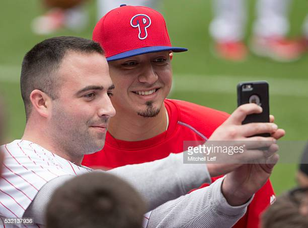 Vince Velasquez of the Philadelphia Phillies takes a selfie with a fan prior to the game against the Miami Marlins at Citizens Bank Park on May 18...