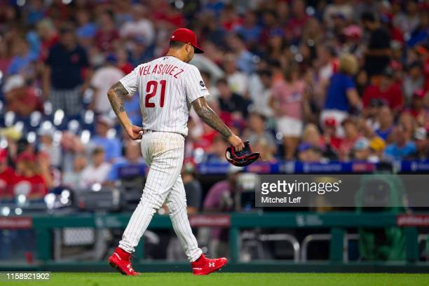Vince Velasquez of the Philadelphia Phillies walks to the dugout after being taken out of the game in the top of the sixth inning against the San...