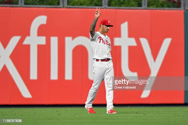 Vince Velasquez of the Philadelphia Phillies waves to the crowd after throwing out a runner at home from left field in the 14th inning against the...