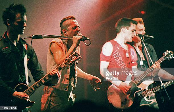 Vince White Joe Strummer Nick Sheppard and Paul Simonon of The Clash perform on stage at the Brixton Academy on March 8th 1984 in London England