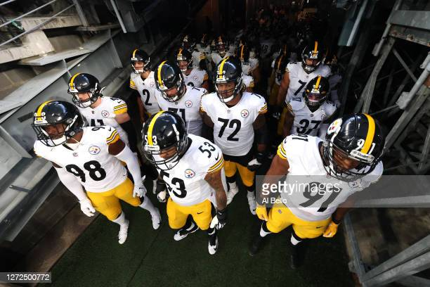 Vince Williams, Maurkice Pouncey and Stephon Tuitt of the Pittsburgh Steelers wait to take the field prior to the game against the New York Giants at...