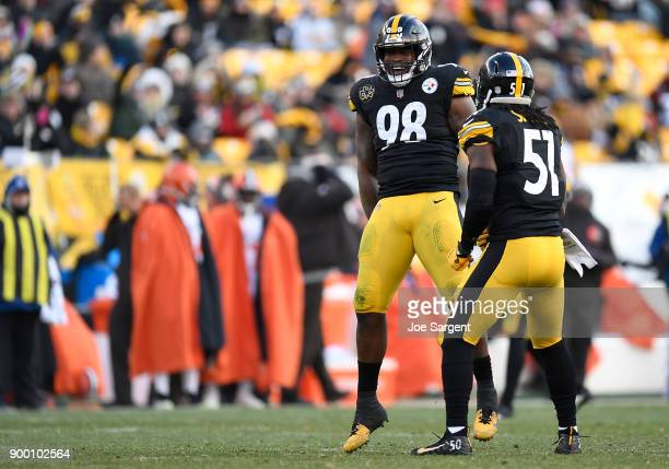 Vince Williams of the Pittsburgh Steelers celebrates with Sean Spence after a sack of DeShone Kizer of the Cleveland Browns in the second quarter...