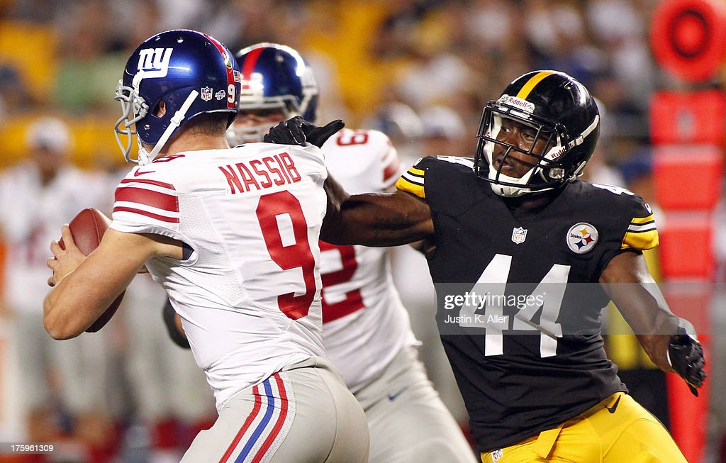 Vince Williams #44 of the Pittsburgh Steelers sacks Ryan Nassib #9 of the New York Giants during the game on August 10, 2013 at Heinz Field in Pittsburgh, Pennsylvania.