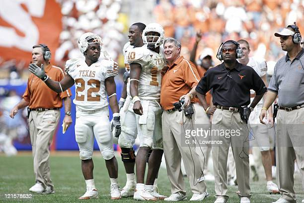 Vince Young and head coach Mack Brown are all smiles as the Texas Longhorns defeated the Colorado Buffalos 70-3 in the Big 12 Championship at Reliant...