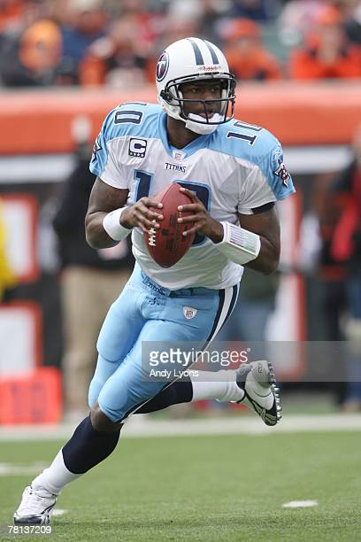 Vince Young of the Tennessee Titans carries the ball during the NFL game against the Cincinnati Bengals at Paul Brown Stadium on November 25 2007 in...