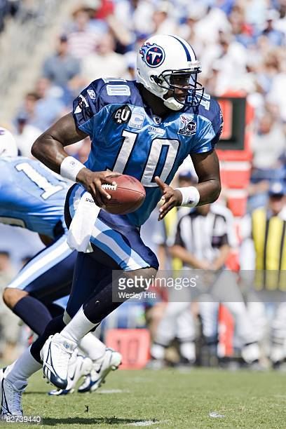 Vince Young of the Tennessee Titans drops back to make a hand off against the Jacksonville Jaguars at LP Field on September 7, 2008 in Nashville,...
